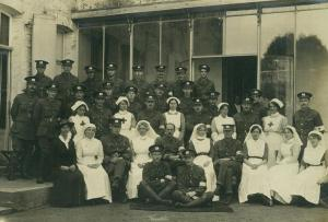 Eckersley second row on left standing with nursescomp